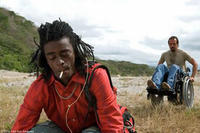 Seu Jorge as Amparo de Jesus and Fele Martinez as Marco in