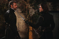 Lambert Wilson as Comte de Chabannes and Gaspard Ulliel as Henri de Guise in