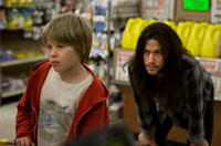 Devin Brochu as TJ and Joseph Gordon-Levitt as Hesher in