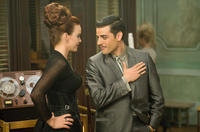 Carla Gugino as Madam Gorski and Oscar Isaac as Blue Jones in