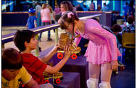 Zachary Gordon as Greg Heffley and Laine MacNeil as Patty Farrell in