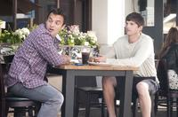 Jake Johnson as Eli and Ashton Kutcher as Adam in