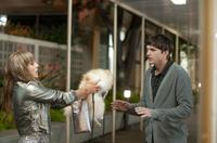 Ophelia Lovibond as Vanessa and Ashton Kutcher as Adam in