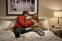Ashton Kutcher as Adam and Natalie Portman as Emma in