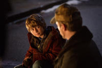 Ty Simpkins as Harley and Robert Downey, Jr. as Tony Stark in