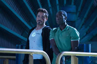 Robert Downey, Jr. as Tony Stark and Don Cheadle as James