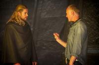 "Chris Hemsworth and director Alan Taylor on the set of ""Thor: The Dark World."""