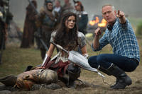 """Jaimie Alexander and director Alan Taylor on the set of """"Thor: The Dark World."""""""
