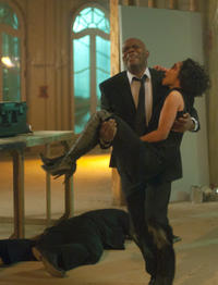 Samuel L.Jackson as Foley and Ruth Negga as Iris in