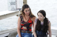 Rainey Qualley as Maddie Fine and Jodelle Ferland as Natalie Fine in