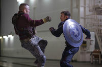 George St-Pierre as Georges Batroc and Chris Evans as Captain America in