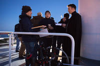 Director Joe Russo, director Anthony Russo and Chris Evans on the set of