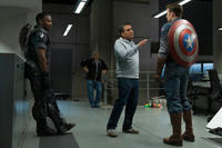 Anthony Mackie, director Joe Russo and Chris Evans on the set of