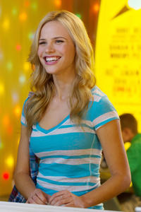 Halston Sage as Nancy Arbuckle in