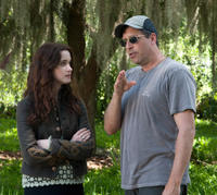 Alice Englert and director Richard LaGravenese on the set of