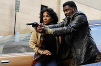 Halle Berry as Louisa Ray and Keith David as Napier in