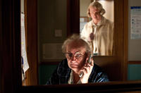 Jim Broadbent as Timothy Cavendish and Hugo Weaving as Nurse Noakes in