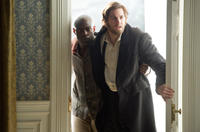 David Gyasi as Autua and Jim Sturgess as Adam Ewing in