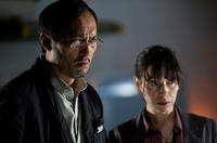 Ken Watanabe as Dr. Ishiro Serizawa and Sally Hawkins as Dr. Vivienne Graham in