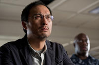Ken Watanabe as Dr. Ishiro Serizawa and Richard T. Jones as Captain Russell Hampton in