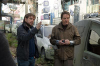 Director Gareth Edwards and Bryan Cranston on the set of