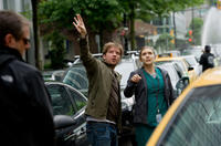 Director Gareth Edwards and Elizabeth Olsen on the set of