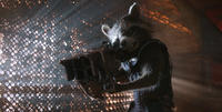 Rocket Racoon voiced by Bradley Cooper in