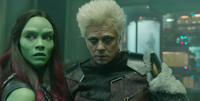 Zoe Saldana as Gamora and Benicio Del Toro as The Collector in
