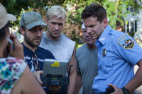 Director Derek Cianfrance, Ryan Gosling and Bradley Cooper on the set of
