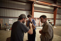 Director Derek Cianfrance, Bradley Cooper and Ben Mendelsohn on the set of