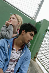 Ashley Hinshaw as Angelina and Dev Patel as Andrew in