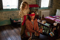 Kyla Deaver as April and Lili Taylor as Carolyn Perron in