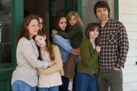 Lili Taylor as Carolyn Perron, Hayley Mcfarland as Nancy, Mackenzie Foy as Cindy, Shanley Caswell as Andrea, Kyla Deaver as April, Joey King as Christine and Ron Livingston as Roger Perron in