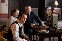 Vera Farmiga as Lorraine Warren, Patrick Wilson as Ed Warren and Steve Coulter as Father Gordon in