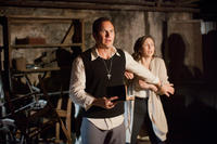 Patrick Wilson as Ed Warren and Vera Farmiga as Lorraine Warren in