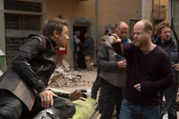 Jeremy Renner and director Joss Whedon on the set of