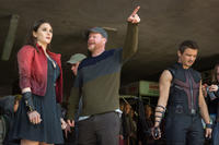 Elizabeth Olsen, director Joss Whedon and Jeremy Renner on the set of