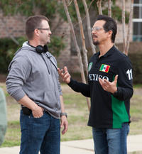 Director Ric Roman Waugh and Benjamin Bratt on the set of