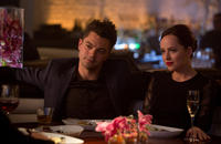 Dominic Cooper as Dino Brewster and Dakota Johnson as Anita in