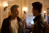 Aaron Paul as Tobey Marshall and Dominic Cooper as Dino Brewster in