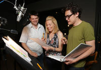 Director Christopher Miller, Elizabeth Banks and director Phil Lord on the set of