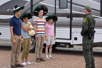 Jason Sudeikis as David Clark, Jennifer Aniston as Rose O'Reilly, Will Poulter as Kenny Rossmore, Emma Roberts as Casey Mathis and Kevin Dorff as Border Guard in