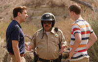 Jason Sudeikis as David Clark, Luis Guzman as Mexican Cop and Will Poulter as Kenny Rossmore in