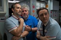 Javier Camara, director Pedro Almodovar and Carlos Areces on the set of