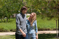 Ashton Kutcher as Steve Jobs and Abby Brammell as Laurene Jobs in