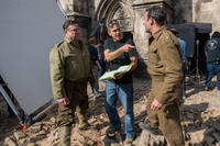 John Goodman, director George Clooney and Jean Dujardin on the set of