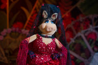 Miss Piggy voiced by Eric Jacobson in