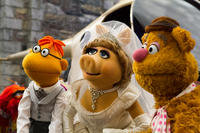Scooter, Miss Piggy and Fozzie Bear in