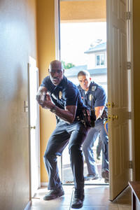 Morris Chestnut as Officer Phillips and David Otunga as Officer Devans in