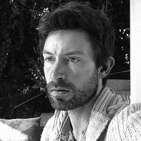 Director Shane Carruth on the set of